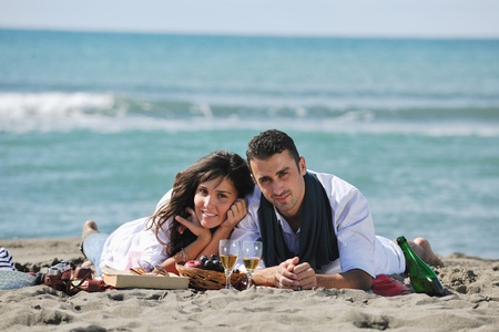 happy young couple enjoying  picnic on the beach and have good time on summer vacations Stock Photo - 8237011
