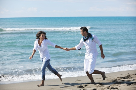 happy young couple in white clothing  have romantic recreation and   fun at beautiful beach on  vacations Stock Photo - 8237227