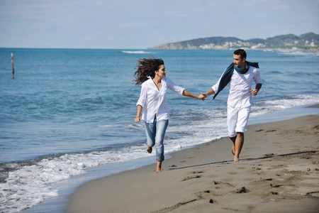 happy young couple in white clothing  have romantic recreation and   fun at beautiful beach on  vacations Stock Photo - 8237027