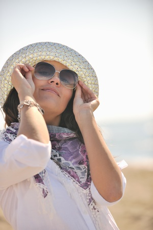 happy young woman relax onbeautiful  beach at morning Stock Photo - 8236123
