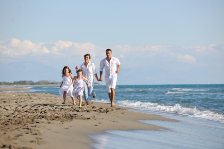 happy young family in white clothing have fun at vacations on beautiful beach  Stock Photo - 8236441