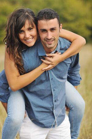 happy young couple have romantic time outdoor while smiling and hug Stock Photo - 8237679