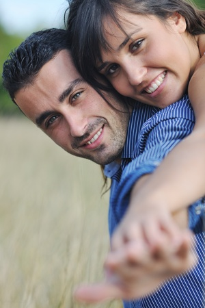 happy young couple have romantic time outdoor while smiling and hug Stock Photo - 8237418