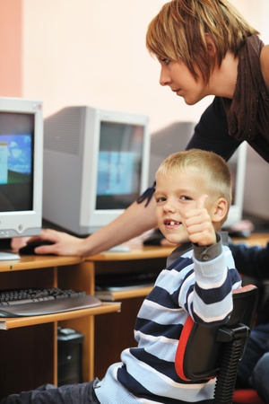 grade: it education with children group  in school at computer science class learning leassons and practice typing