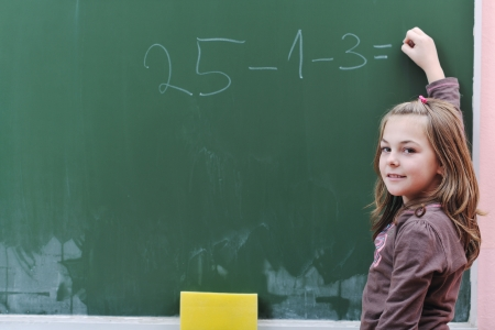happy school girl on math classes finding solution and solving problems Stock Photo - 8304177