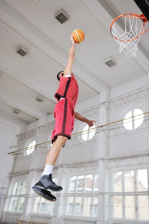 young and healthy people man have recreation and training exercise  while play basketball game at sport gym indoor hall Stock Photo - 8247246