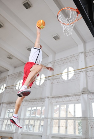sport hall: young and healthy people man have recreation and training exercise  while play basketball game at sport gym indoor hall