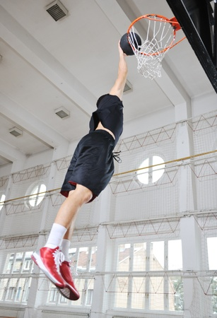 young and healthy people man have recreation and training exercise  while play basketball game at sport gym indoor hall Stock Photo - 8311005