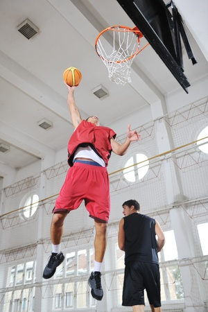 young and healthy people man have recreation and training exercise  while play basketball game at sport gym indoor hall Stock Photo - 8311020