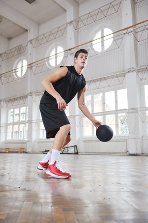 young and healthy people man have recreation and training exercise  while play basketball game at sport gym indoor hall photo