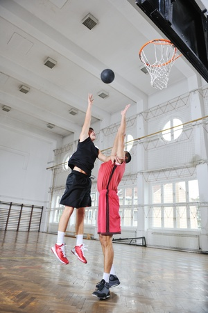 indoor shot: young and healthy people man have recreation and training exercise  while play basketball game at sport gym indoor hall