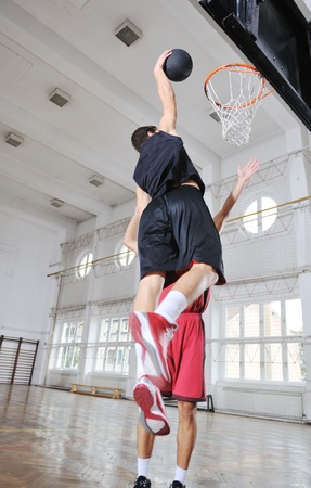 young and healthy people man have recreation and training exercise  while play basketball game at sport gym indoor hall Stock Photo - 8247755