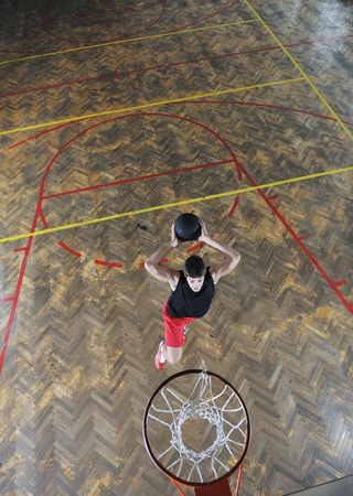 young and healthy people man have recreation and training exercise  while play basketball game at sport gym indoor hall Stock Photo - 8311484