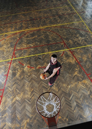young and healthy people man have recreation and training exercise  while play basketball game at sport gym indoor hall Stock Photo - 8311482
