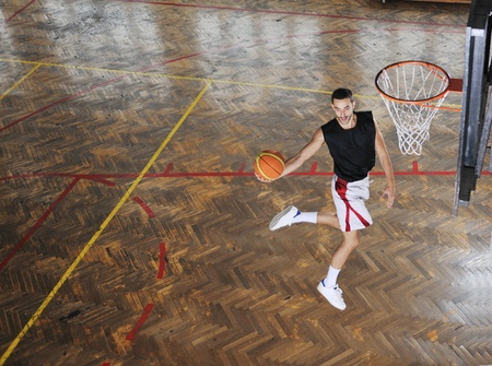 young and healthy people man have recreation and training exercise  while play basketball game at sport gym indoor hall Stock Photo - 8311025