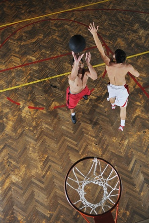 young and healthy people man have recreation and training exercise  while play basketball game at sport gym indoor hall Stock Photo - 8311485
