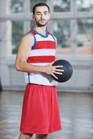 young and healthy people man have recreation and training exercise  while play basketball game at sport gym indoor hall Stock Photo - 8311112