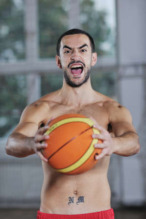 young and healthy people man have recreation and training exercise  while play basketball game at sport gym indoor hall Stock Photo - 8311113