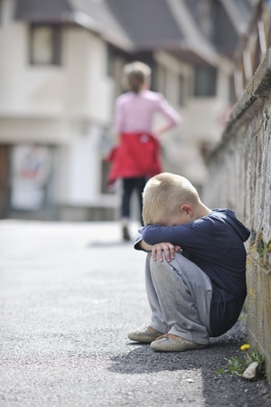 lonely boy: sad and unhappy alone child cry and have emotion problem on street