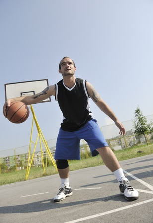 basketball player practicing and posing for basketball and sports athlete concept photo