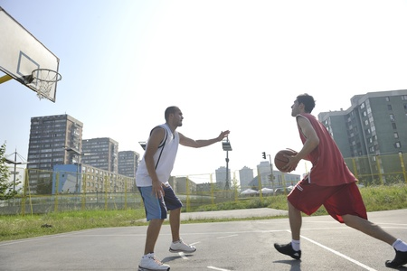streetball basketball game with two young player at early morning on city court photo