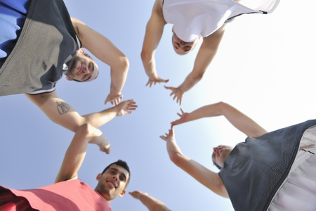 basketball player team group  posing on streetbal court at the city on early morning photo