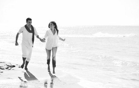 happy young couple in white clothing  have romantic recreation and   fun at beautiful beach on  vacations Stock Photo - 8313495
