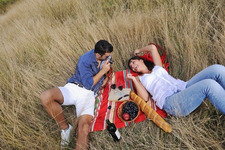 happy young couple relaxing in nature white making photos and taking images and posing for camera Stock Photo - 8327919