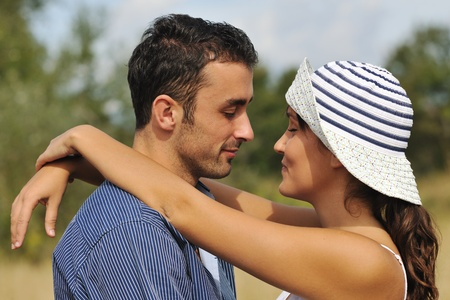 happy young couple have romantic time outdoor while smiling and hug Stock Photo - 8327791