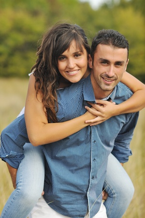 happy young couple have romantic time outdoor while smiling and hug photo