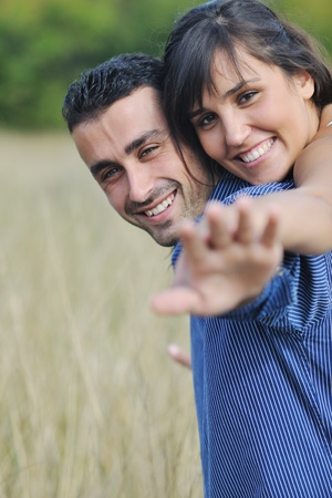happy young couple have romantic time outdoor while smiling and hug Stock Photo - 8327652
