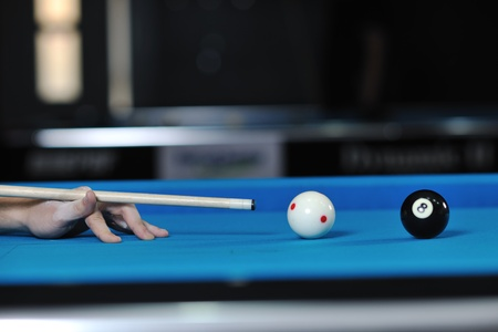 billard: young pro billiard player finding best solution and right angle at billard or snooker pool sport  game
