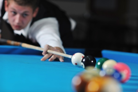 poolball: young pro billiard player finding best solution and right angle at billard or snooker pool sport  game