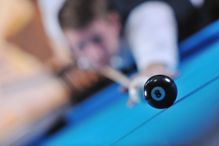 young pro billiard player finding best solution and right angle at billard or snooker pool sport  game  Stock Photo - 8325953