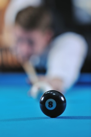 young pro billiard player finding best solution and right angle at billard or snooker pool sport  game  Stock Photo - 8326086