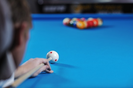 snooker tables: young pro billiard player finding best solution and right angle at billard or snooker pool sport  game