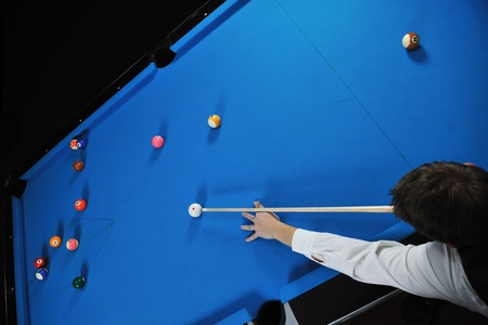 young pro billiard player finding best solution and right angle at billard or snooker pool sport  game Stock Photo - 8327610