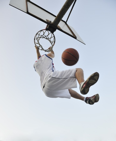 street shot: basketball player practicing and posing for basketball and sports athlete concept