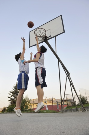 basketball shot: woman basketball player have treining and exercise at basketball court at city on street Stock Photo