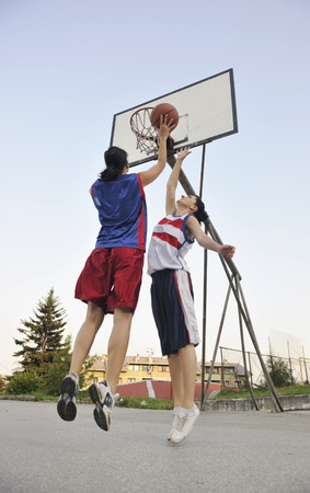 woman basketball player have treining and exercise at basketball court at city on street photo