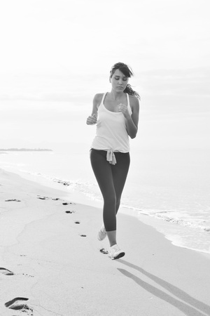 young healthy woman jogging and running at beach at early morning  Stock Photo - 8313778