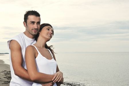 happy young couple in white clothing  have romantic recreation and   fun at beautiful beach on  vacations Stock Photo - 8313957
