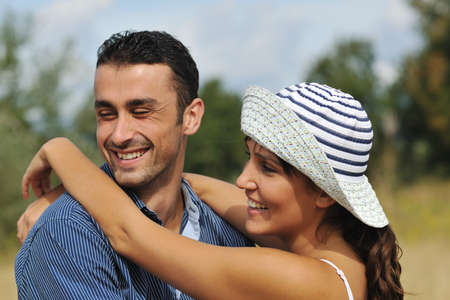 happy young couple have romantic time outdoor while smiling and hug Stock Photo - 8327705
