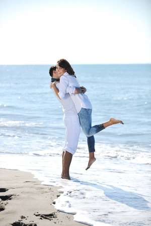 happy young couple in white clothing  have romantic recreation and   fun at beautiful beach on  vacations photo