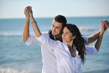 happy young couple in white clothing  have romantic recreation and   fun at beautiful beach on  vacations Stock Photo - 8326221