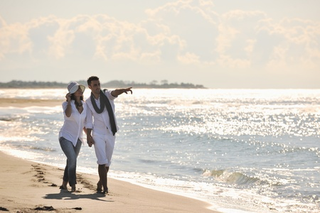 happy young couple in white clothing  have romantic recreation and   fun at beautiful beach on  vacations Stock Photo - 8326430