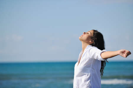 happy young woman relax onbeautiful  beach at morning Stock Photo - 8313912