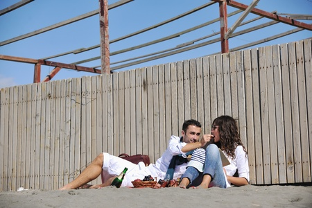 happy young couple enjoying  picnic on the beach and have good time on summer vacations Stock Photo - 8327738