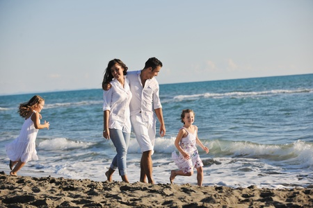 happy young family in white clothing have fun at vacations on beautiful beach Stock Photo - 8326661