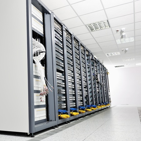 data storage: internet network server room with computers racks and digital receiver for digital tv Stock Photo